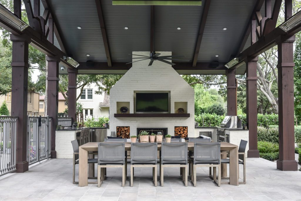 Outdoor loving space with a kitchen and large fireplace making it the perfect summer get-away! Remolded by Houston's best, LBJ Construction.